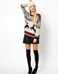 white red and black printed sweater with mini pleated skirt