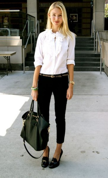 white ruffle button up shirt with black cuffed jeans and tassel loafers