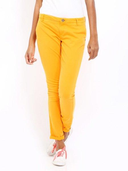 white short sleeve tee with lemon yellow slim fit pants