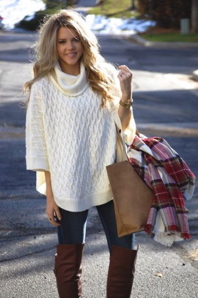 white turtleneck half sleeve poncho sweater with black skinny jeans