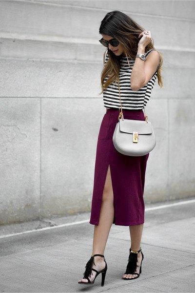 black and white sleeveless top with midi slit skirt