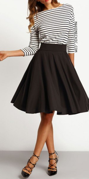 black and white striped long sleeve tee with knee length skater skirt