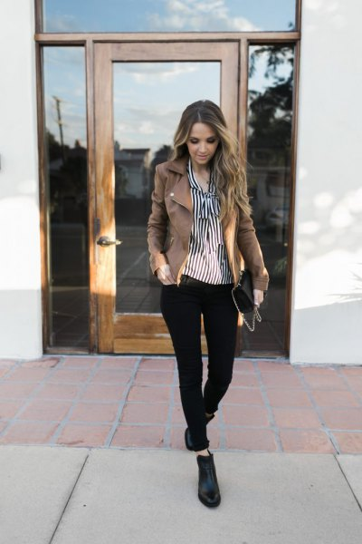 black and white vertical striped button up shirt with grey denim blazer
