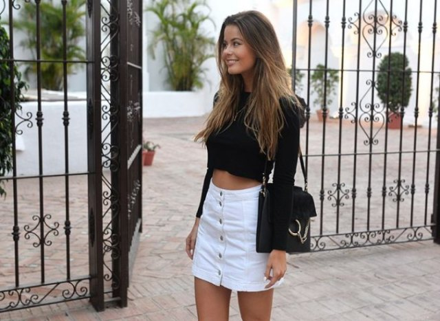 black cropped fitted sweater with white high waisted mini button front skirt