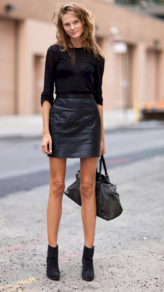 black fitted sweater with leather skirt and suede mini boots