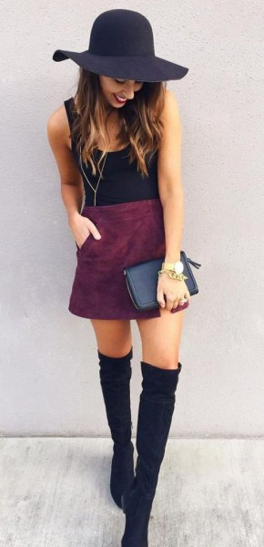 black floppy hat with tank top with suede skirt