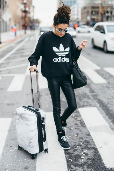 black graphic sweatshirt with leather leggings and sweaters