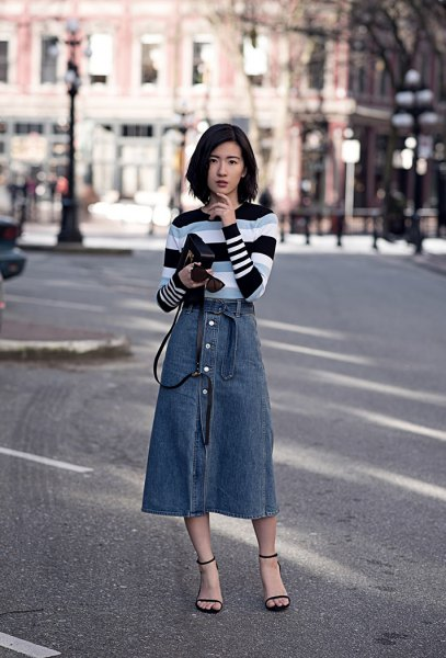 black grey and white striped sweater with blue midi button front skirt
