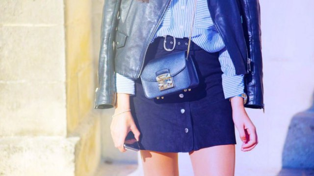 black leather jacket with blue and white striped button up shirt