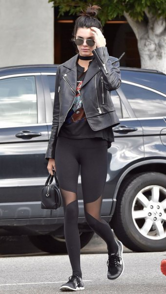 black leather jacket with graphic tee and meshed workout leggings