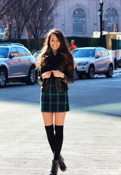 black leather jacket with navy plaid mini skirt and ankle boots