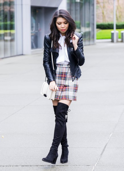 black leather jacket with white ribbon blouse and pink mini skirt