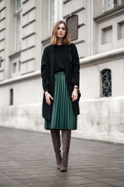 black longline blazer with grey pleated midi skirt and thigh high boots