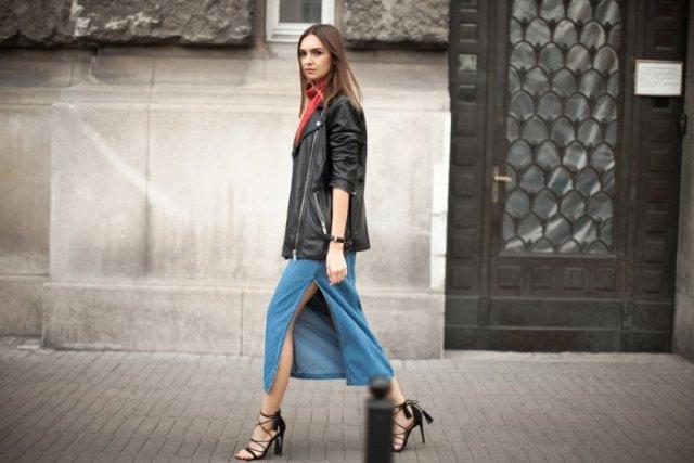 black oversized leather jacket with blue high slit midi denim skirt