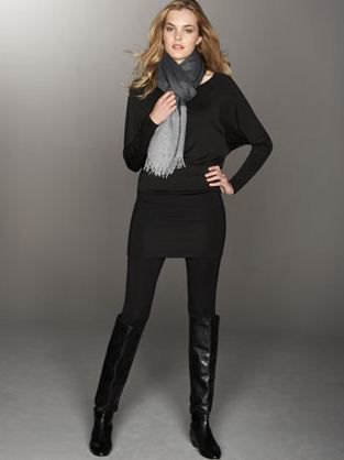 black pullover sweater with leggings and knee high boots