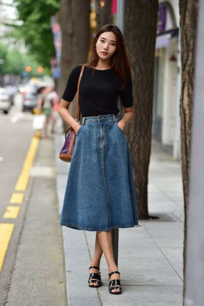 black short sleeve fitted t shirt with blue denim long skirt and sandals