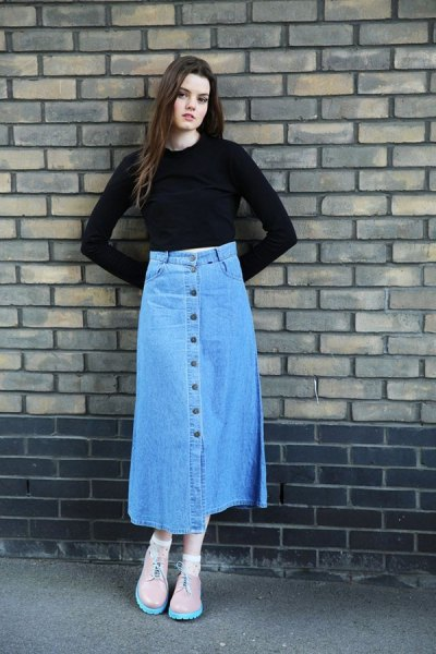 black slightly cropped bell sleeve top with blue long denim button front skirt