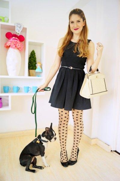 black tank belted mini skater dress with polka dot stockings and ballet heels