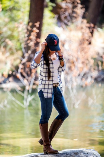 blue and white plaid hiking jacket with grey leather knee high boots