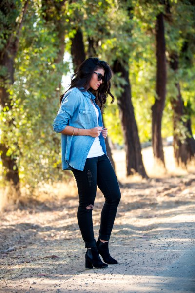 blue casual blouse with black ripped jeans and heeled boots