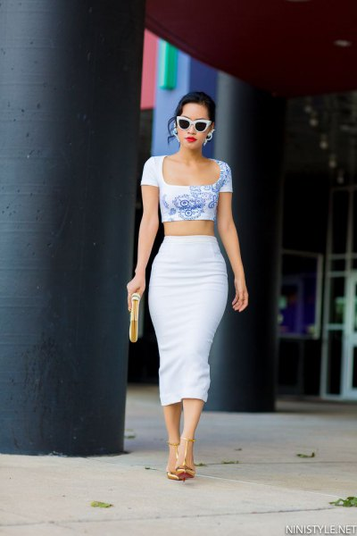 blue printed cropped form fitting tee with high waisted white skirt