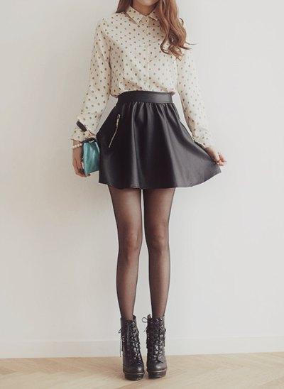 blush pink polka dot shirt with black high waisted mini skater skirt