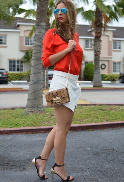 bright orange button up shirt with white mini skort