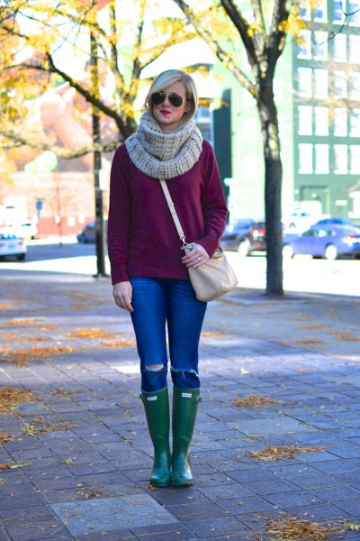 chunky knit sweater with grey scarf and leather knee high boots