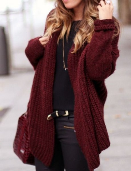 chunky maroon sweater cardigan with black tee and leather moto pants