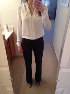 cream blouse with black chinos and leather ankle boots