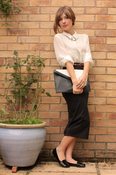 cream button up tucked shirt with black midi straight cut dress
