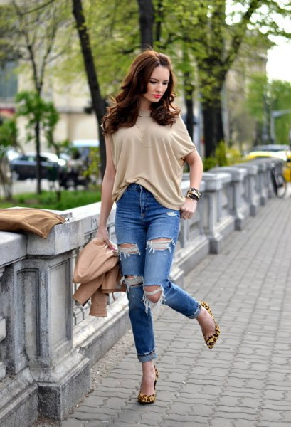 cream short sleeve blouse with ripped cuffed jeans