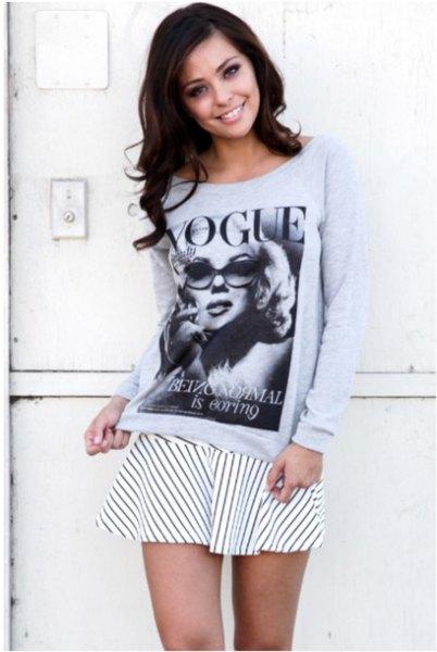 gray graphic sweatshirt with white and black striped skater mini skirt