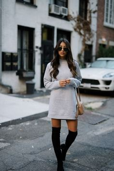 grey crew neck sweatshirt dress with black thigh high boots
