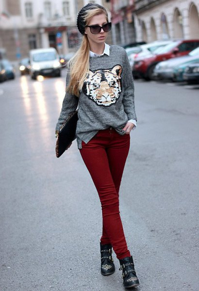 grey graphic sweater with white button up shirt and maroon skinny jeans