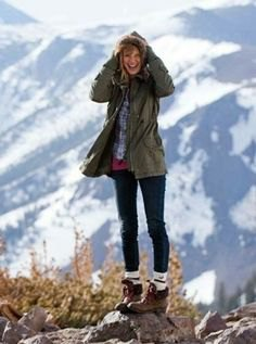 grey parka jacket with navy and white plaid hiking shirt and boots