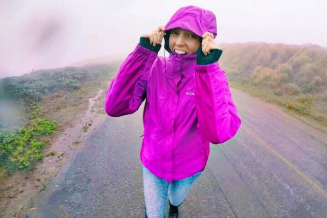 hot pink hiking jacket with light blue washed skinny jeans