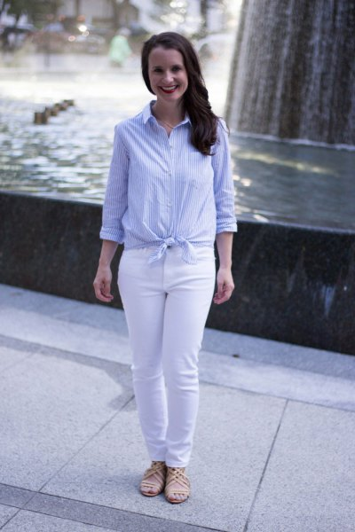light blue and white vertical striped knotted shirt with slim fit jeans