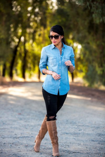 light blue denim shirt with black ripped jeans and camel heeled knee high boots