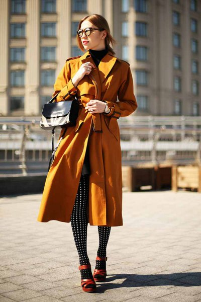lime green longline trench coat with black and white polka dot leggings