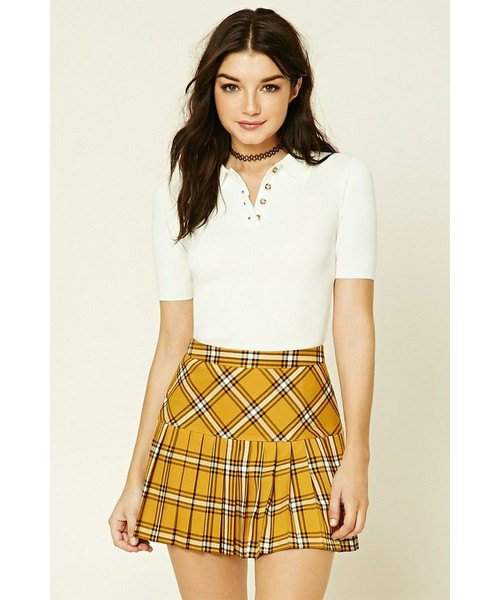 mustard yellow plaid pleated mini skirt with white fitted polo shirt