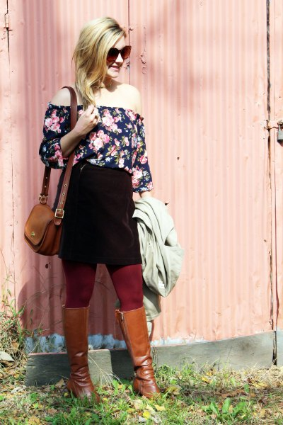 off the shoulder black and white floral printed blouse with black skirt and brown boots