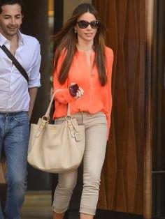 orange chiffon blouse with light green slim fit cuffed jeans