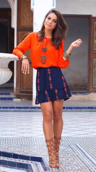 orange crew neck blouse with blue mini skater skirt