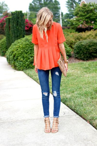 orange peplum blouse with ripped skinny jeans