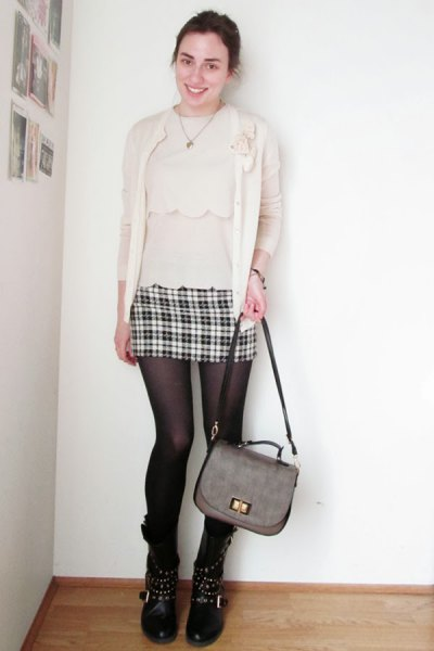pale pink blouse with matching cardigan and mini skirt