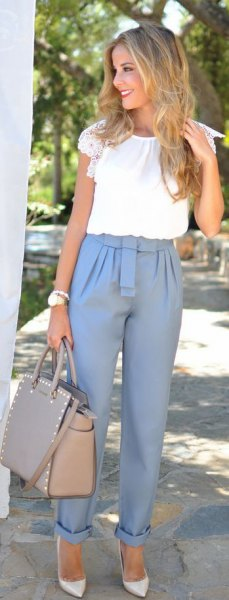 pink cuffed dress pants with white short sleeve blouse