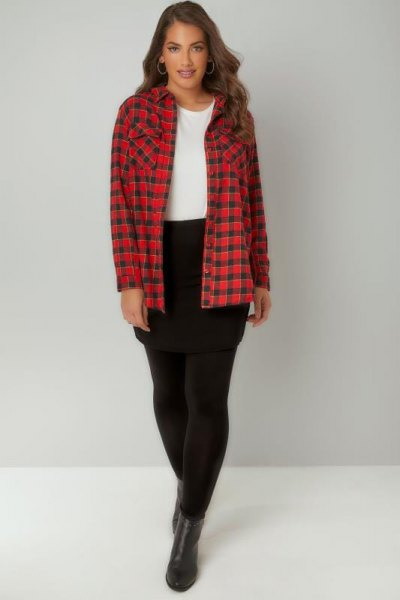 red and black plaid shirt with leggings and short leather boots