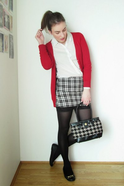 red sweater cardigan with black and white plaid mini skirt