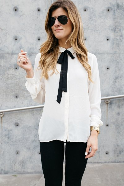white and black tie neck chiffon untucked shirt with skinny jeans